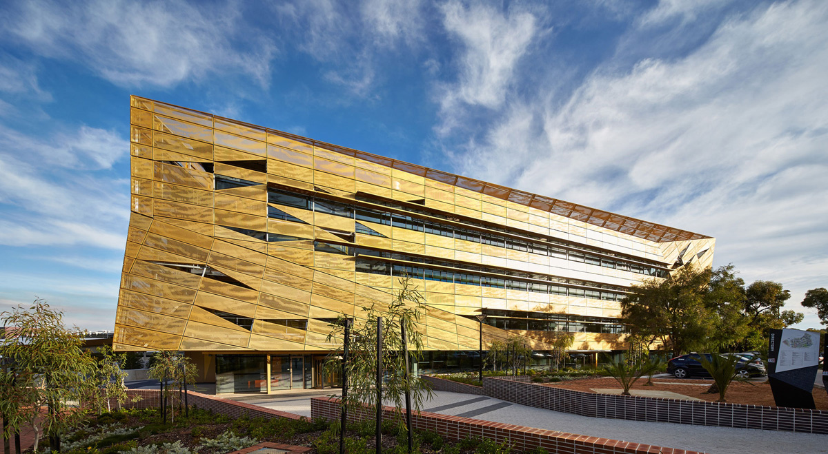 Student services building s shimmering fa ade enhanced for Architecture design company in australia